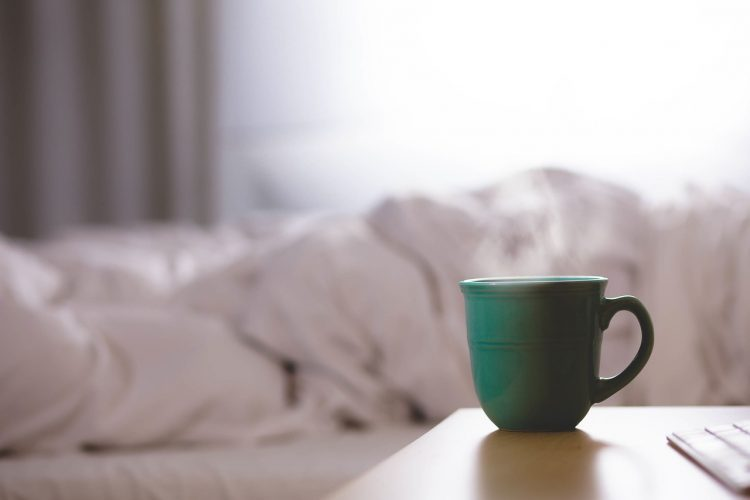Background of bedding and cup of coffee